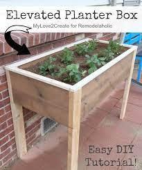this diy elevated planter box is raised