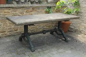 substantial stone topped cast iron garden table