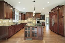 light wood floors with dark kitchen cabinets will be a