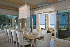 modern chandeliers dining room beach style with glass wall open to outside light wood flooring