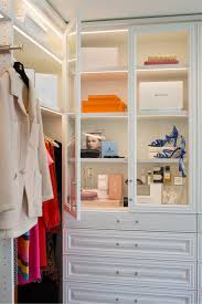 natasha did something unique when she designed the closet she used our glass doors to enclose shelving with integrated lighting to create unforgettable