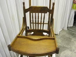 we have for sale an extra nice antique victorian style high chair that converts to a stroller it is in mint condition the cane seat is great along with antique high chairs wooden
