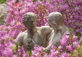 statue of eve giving adam an apple in the garden of eden section of