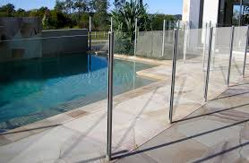 the semi frameless glass pool fencing system combines the stylish look of glass with the strength and durability of a framed system