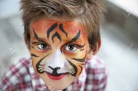 cute little boy with aqua makeup of tiger muzzle stock photo 109499363
