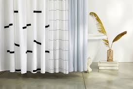 brooklinen s chic new shower curtain is the easiest way to upgrade your bathroom