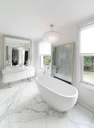 bathroom white framedoors cream fur rug natural wood frame mirror brown floor tile plain wall