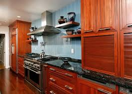 cherry kitchen cabinets black granite. trendy kitchen photo in dc metro with granite countertops, paneled appliances, raised-panel cherry cabinets black k