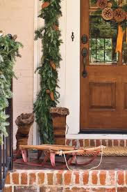 how to hang garland around front doorSpectacular Holiday Entry and Christmas Door Decorations
