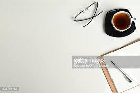 Office Table Top View Shot With Tea Cup Notebook Eyeglass And Pen