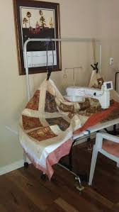 Improvise! Bungee cord system to hold up quilt and eliminate the ... & One of the ladies on my quilting forum has designed a system for holding up  quilts to prevent drag when the quilt falls off the edge of the table, ... Adamdwight.com