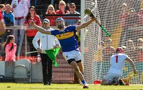 john mcgrath of tipperary celebrates after scoring his side s second goal past cork goalkeeper anthony nash