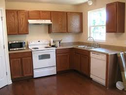 painted kitchen cabinets with white appliances. Painting Kitchen Cabinets Contractors Step 2 Paint Reverse Side Better Homes Gardens 0 . Painted With White Appliances