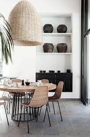 huge woven pendant and natural materials in this dining room