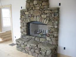 and cons river rock fireplace how build amusing wall lamp near floating mantel stone surround