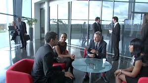 group contemporary office. large multi ethnic business group in relaxed meeting area of a contemporary office building high quality hd video footage stock 4479608