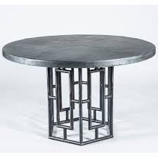 rincon round zinc top dining table base shown in fire
