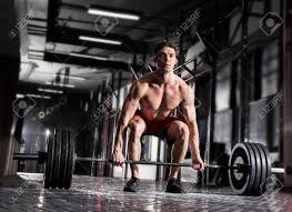 stock photo young shirtless man doing deadlift exercise at gym