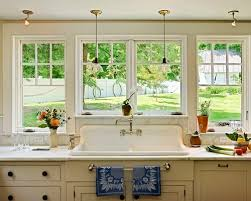 over the sink lighting. traditional kitchen idea in burlington with a dropin sink marble countertops white over the lighting