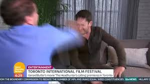 calling back after interview good morning britains ross king punches gerard butler in a live tv
