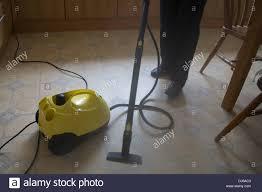 Kitchen Floor Steam Cleaner Close Up Woman Using A Steam Cleaner To Clean Kitchen Floor Stock