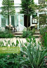 from this pale green garden apartment sliding doors open onto an interior courtyard the