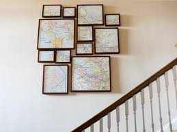 modern staircase with artistic map display on modern framed wall pictures with how to create fractured framed map art hgtv