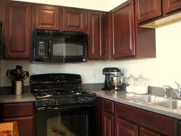 painted kitchen cabinets with black appliances. White Kitchens With Black Appliances Brown Faux Leather Bar Stool Matching Wooden Green Glass Mosaic Backsplash Painted Kitchen Cabinets
