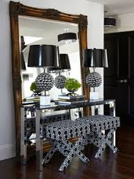 atmosphere interior design modern foyer entrance with ornate floor mirror polished chrome console table white black x ottomanetal ls with