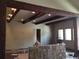 lighting for beams. Wood Ceiling Lighting. Interior Design, Old World Traditions For Faux Beams Design And Lighting