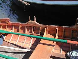 here is an interesting setup of removable curved thole pins forming a wooden oarlock on a friend s boat in eureka
