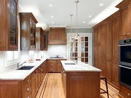 a kitchen with stained oak cabinets and white most popular quartz countertop colors 2017