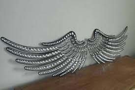 bathroom beautiful angel wings wall decor remarkable ideas wing plush best about pertaining to drop dead