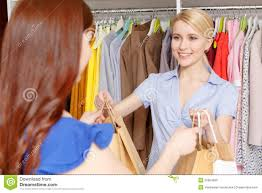s assistant gives bags to the customer stock photo image s assistant gives bags to the customer