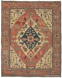left image silk tabriz persian rug with a predominantly curvilinear design right image serapi carpet heriz region northwest persia circa 1875