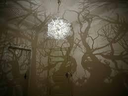 tree branch shadow chandelier
