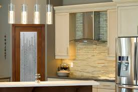 pendant lighting over bar. nice subway kitchen backsplash and hanging pendant lighting over bar table in front of i