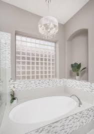 white bathroom with chandelier