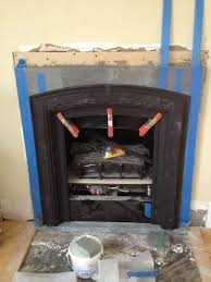 original fireplace was a phony gas insert built out facade with soapstone brick and got a cast iron surround from a salvage for 250