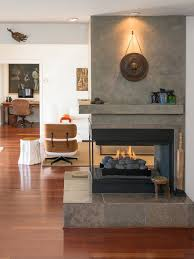 contemporary living room idea in los angeles with a two sided fireplace