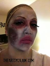 zombie makeup tutorial once dry add the base color and set it with the baby powder and then start