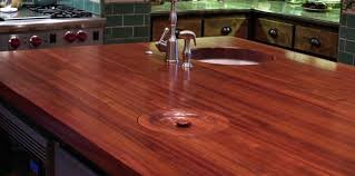 waterlox finish jatoba wood island countertop with hand carved trash lid