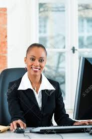paralegal office young female lawyer or paralegal working in her office on a computer