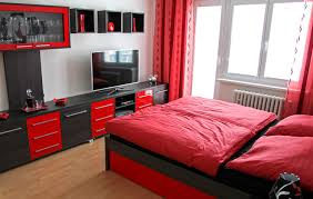 The combination red and black modular furniture adds visual interest and  energy to this bedroom. If you can't find pieces in these colors, ...
