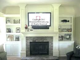 mounting a tv over a fireplace into brick mounting above fireplace mounting above brick fireplace the
