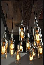combine edison bulbs and single medium base pendant cord with your wine bottles repeat a few times and hang and wire them through reclaimed wood to form a
