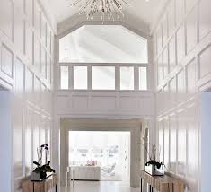 two story foyer chandelier stunning two story foyer white moulding on walls wood side tables dresser