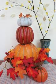 create a stacked pumpkin topiary to decorate your fall tablescape