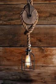 swag ceiling light the wood wheel pulley pendant light rustic industrial cage lighting manila rope swag swag ceiling light