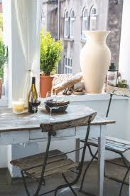 The balcony is decorated with some new and some old elements - a great  combination which